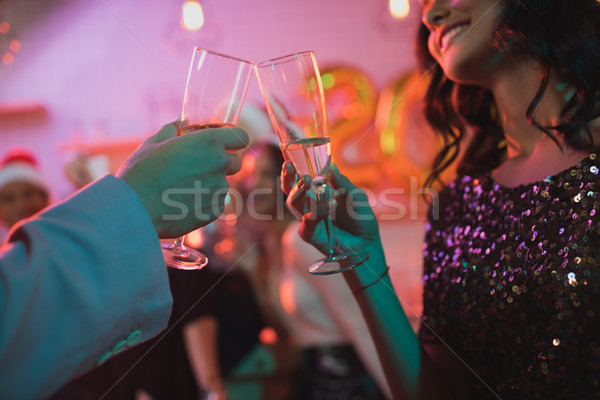 friends clinking glasses of champagne Stock photo © LightFieldStudios
