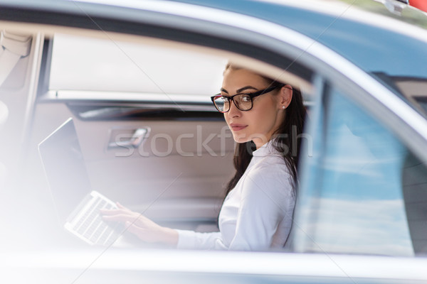 woman using laptop in car Stock photo © LightFieldStudios