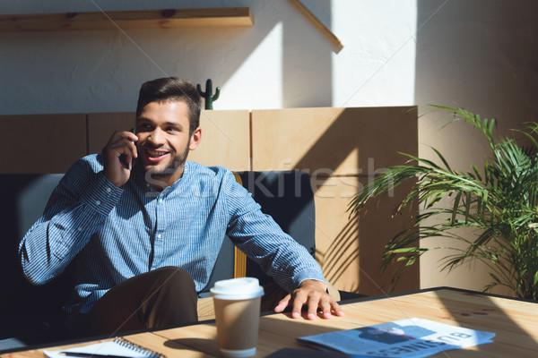man talking on smartphone Stock photo © LightFieldStudios