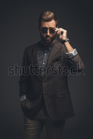 Man in suit looking over sunglasses Stock photo © LightFieldStudios