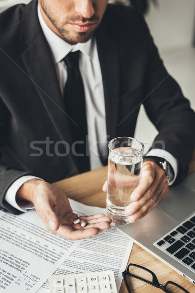 Stock photo: businessman with pills and glass of water
