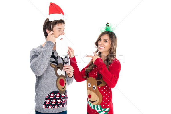 couple with christmas paper accessories Stock photo © LightFieldStudios