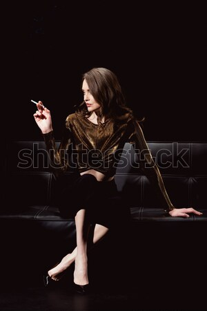 Young woman contemporary dancer posing and looking away on black  Stock photo © LightFieldStudios
