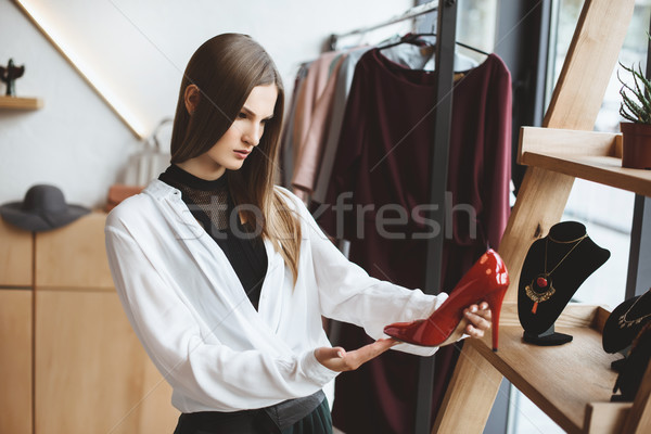 woman choosing elegant heels Stock photo © LightFieldStudios