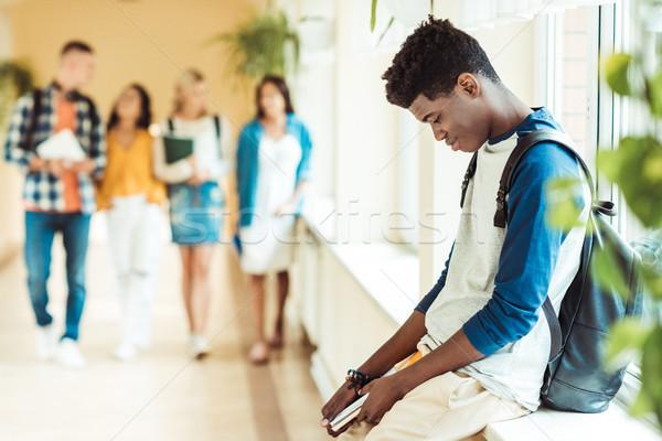 Moe student vergadering vensterbank uitgeput afro-amerikaanse Stockfoto © LightFieldStudios