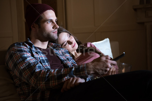 Stock photo: side view of couple watching movie together at home