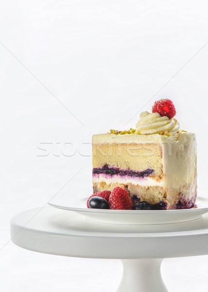 Pieza apetitoso torta blanco stand aislado Foto stock © LightFieldStudios