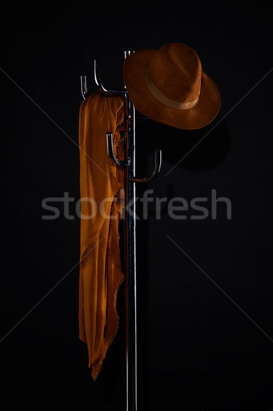 scarf and hat hanging on coat rack isolated on black Stock photo © LightFieldStudios