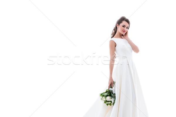 smiling bride posing in traditional white dress with wedding bouquet, isolated on white Stock photo © LightFieldStudios