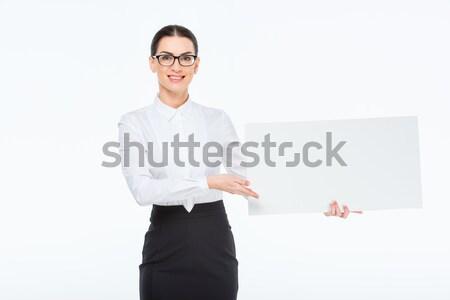 Businesswoman with blank card Stock photo © LightFieldStudios