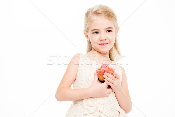 Girl holding cupcake Stock photo © LightFieldStudios