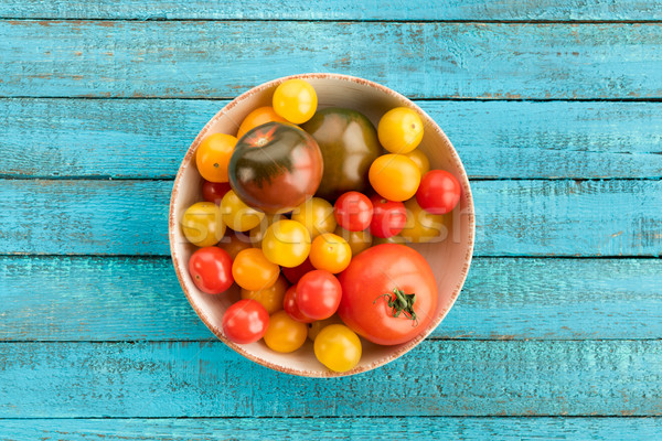 tomatoes in bowl on table Stock photo © LightFieldStudios