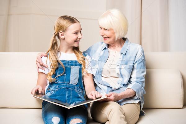 Babcia wnuczka posiedzenia sofa uśmiechnięty Zdjęcia stock © LightFieldStudios
