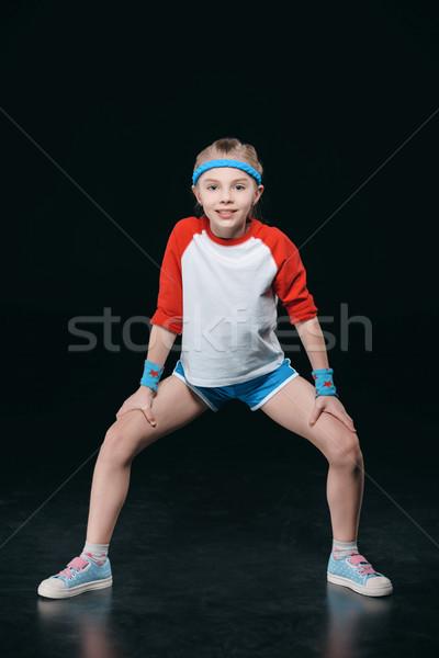かわいい 笑みを浮かべて 少女 スポーツウェア 行使 見える ストックフォト © LightFieldStudios