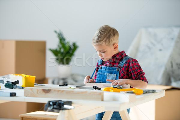 Little boy with tools Stock photo © LightFieldStudios