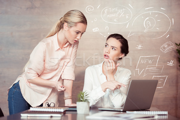 businesswoman with female colleague at office Stock photo © LightFieldStudios