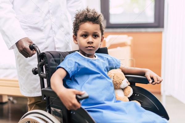 african american boy in wheelchair Stock photo © LightFieldStudios