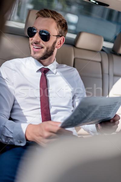 Empresario periódico coche jóvenes gafas de sol feliz Foto stock © LightFieldStudios