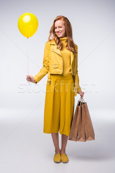 Stock photo: girl with shopping bags and balloon