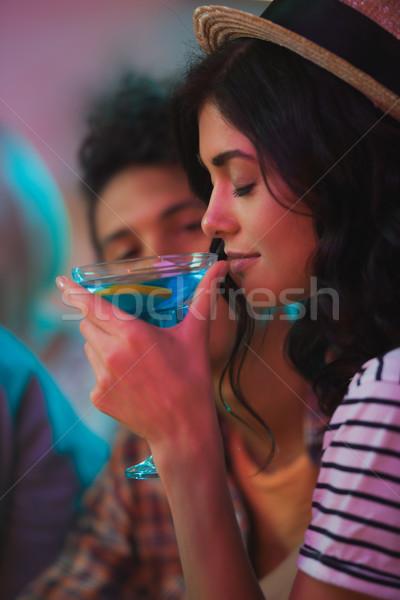 woman smelling cocktail Stock photo © LightFieldStudios