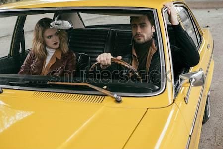 Stock photo: couple in retro styled minivan
