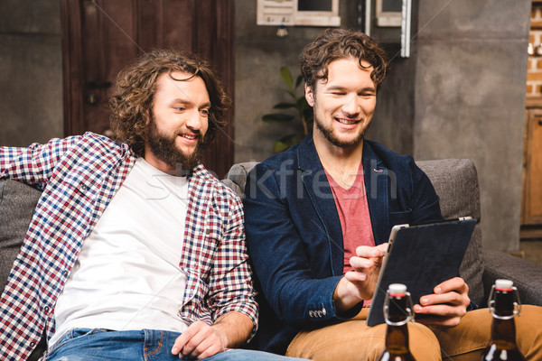 Friends using digital tablet Stock photo © LightFieldStudios
