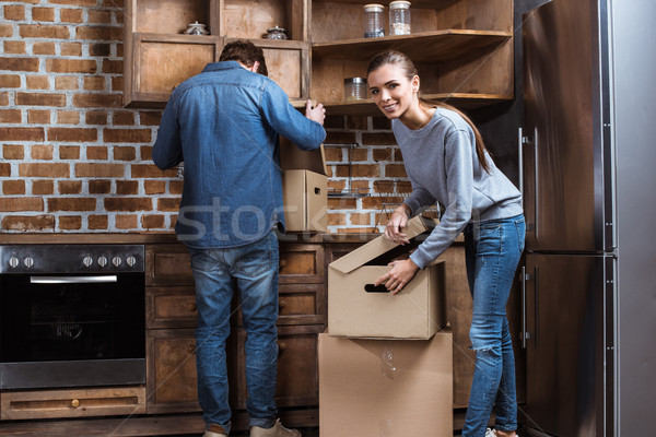 couple unpacking stuff at new home Stock photo © LightFieldStudios