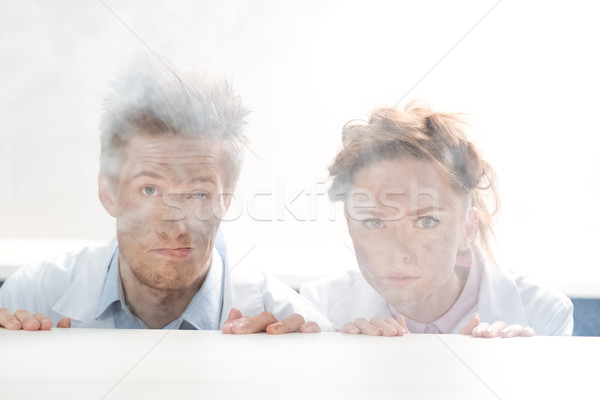 Portret wetenschappers naar uit achter tabel Stockfoto © LightFieldStudios