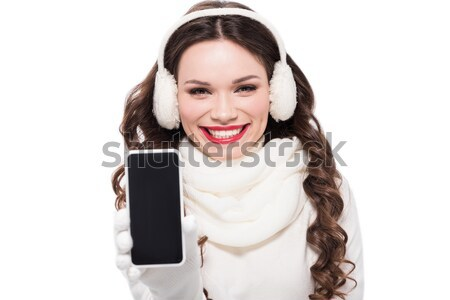 woman in winter clothes holding gift Stock photo © LightFieldStudios