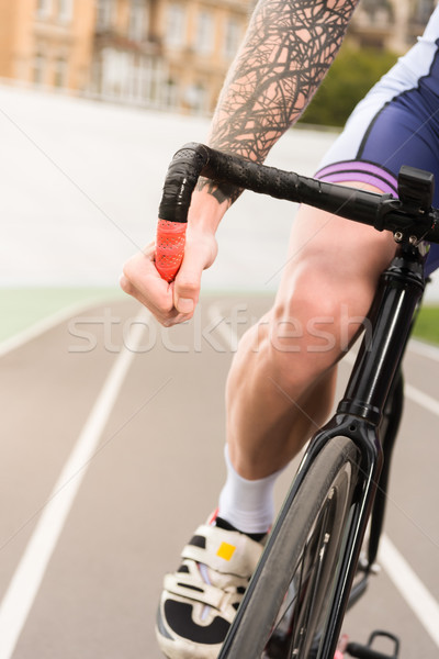 Stock photo: cyclist riding bicycle on cycle race track