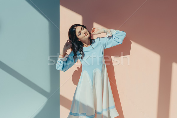 Woman in turquoise dress with closed eyes Stock photo © LightFieldStudios
