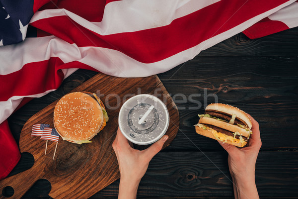 partial view of woman holding burger and soda drink, presidents day celebration concept Stock photo © LightFieldStudios