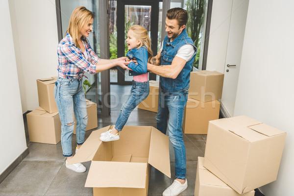 Heureux parents peu fille jouer ensemble Photo stock © LightFieldStudios