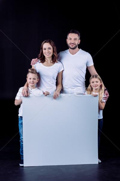 Foto stock: Sonriendo · familia · tarjeta · en · blanco · blanco · tarjeta