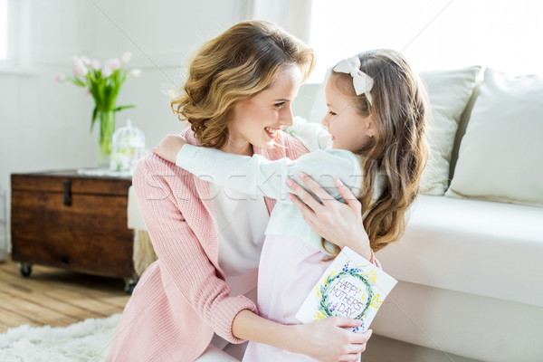 Stock photo: Happy mother and daughter hugging