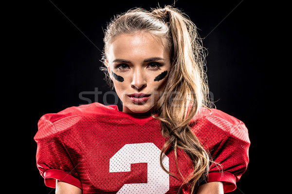 Attractive female american football player Stock photo © LightFieldStudios
