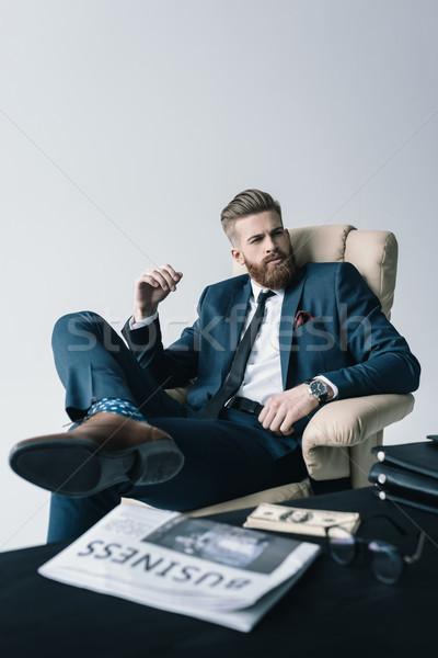 Töprengő elegáns üzletember ül fotel iroda Stock fotó © LightFieldStudios