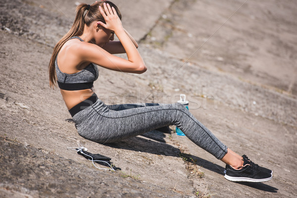 Stock photo: woman doing abs exercise