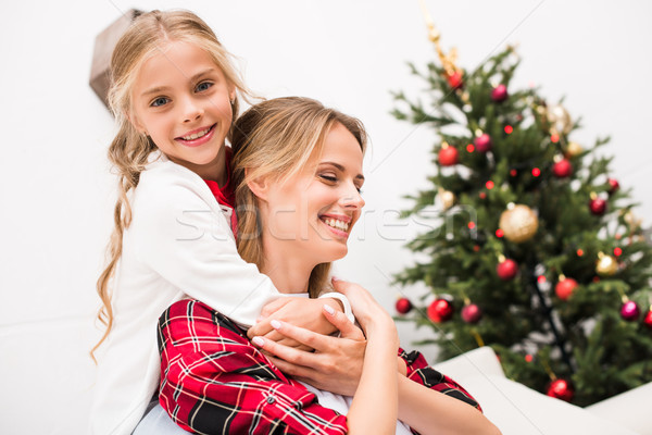 mother and daughter hugging Stock photo © LightFieldStudios