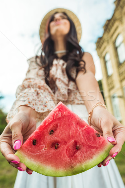 girl holding slice of watermelon Stock photo © LightFieldStudios