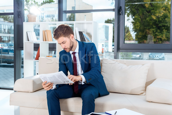 businessman reading newspaper Stock photo © LightFieldStudios