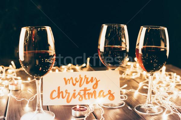 Red wine and merry christmas card Stock photo © LightFieldStudios