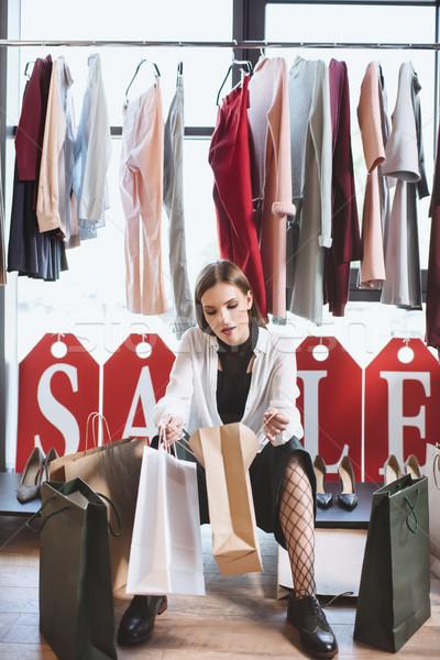 shopper with shopping bags Stock photo © LightFieldStudios