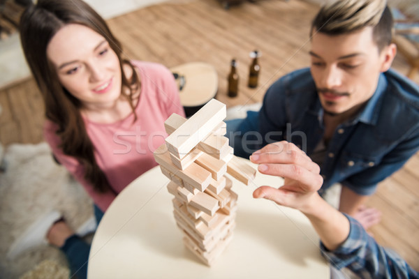 high angle view of friends playing jenga game at home Stock photo © LightFieldStudios