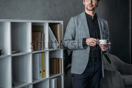 Stock photo: businessman buttoning suit jacket