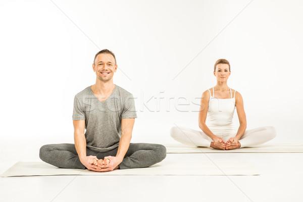 Couple sitting in lotus position  Stock photo © LightFieldStudios