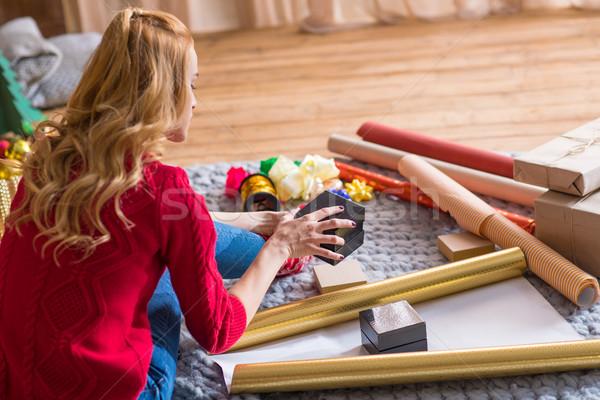 Girl wrapping gift boxes Stock photo © LightFieldStudios