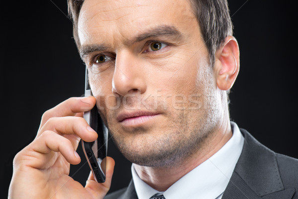 Businessman talking on smartphone  Stock photo © LightFieldStudios