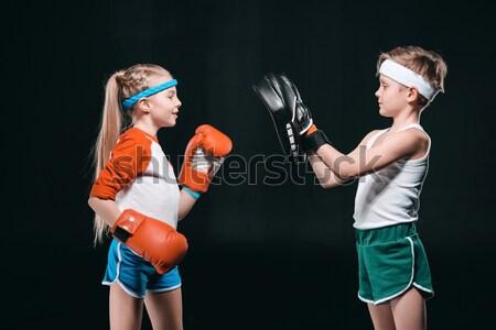 Sorridente menino luvas de boxe isolado preto ativo Foto stock © LightFieldStudios
