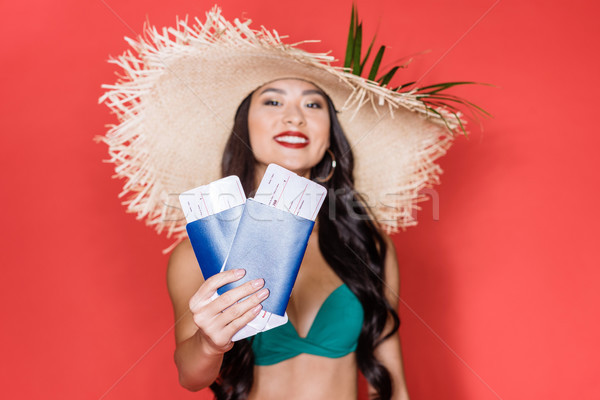 Stock photo: woman in swimsuit showing airplane tickets